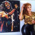 Andrea Mckenzie pose with her Bob Marley exhibit