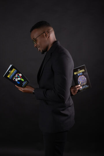 Trinidadian Author- Daniel Francis with his two book releases