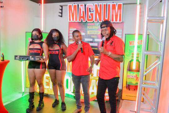From the left Romeich models, Manager for Magnum Kamal Powell and (host) Bishop Escobar